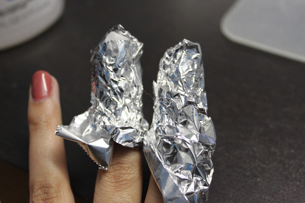 Wrap fingers in cotton and aluminum foil
